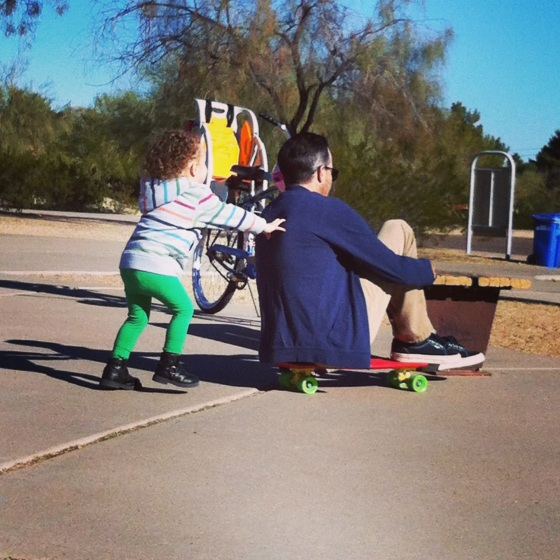 Gwen and Cody at the park skateboarding lessons.